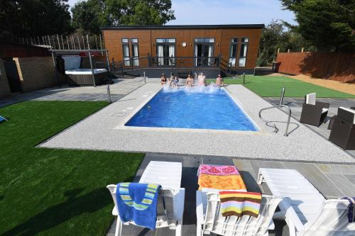 The swimming pool at or near Spanhoe Lodge