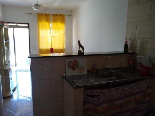 A kitchen or kitchenette at Casa Temporada Cabo Frio