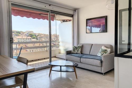 A seating area at New apartment with a view