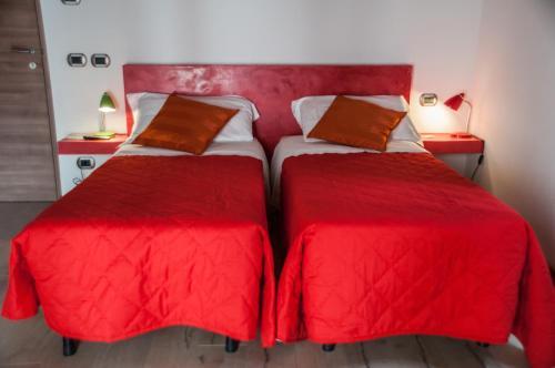 Letto o letti in una camera di B&B Santa Lucia