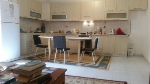 A kitchen or kitchenette at Vlora Backpackers Hostel