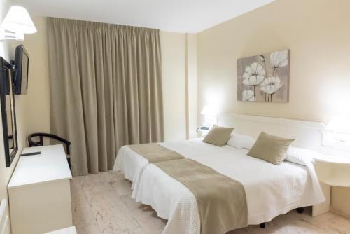 Cama o camas de una habitación en Hotel Ramomar