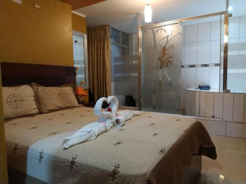 A bed or beds in a room at HOSTAL MILAGROS