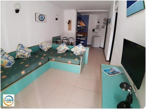 Een zitgedeelte bij Apartments Lloret Sun