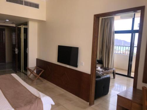 A television and/or entertainment center at Aqaba Gulf Hotel