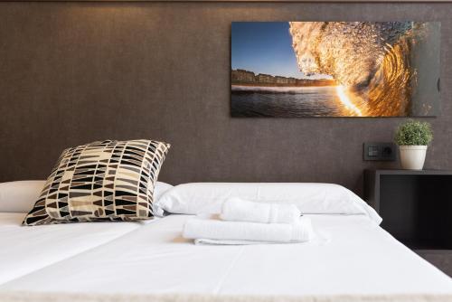 Cama o camas de una habitación en Apartamentos Salbide Zarautz