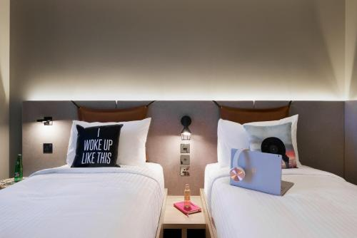 A bed or beds in a room at Moxy Slough