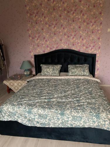 Кровать или кровати в номере Country House on Volga