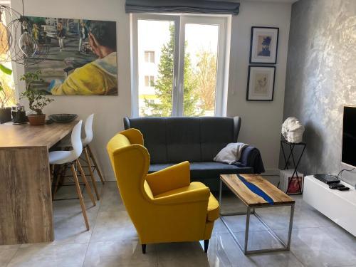A seating area at Apartament Centrum- Art&Design