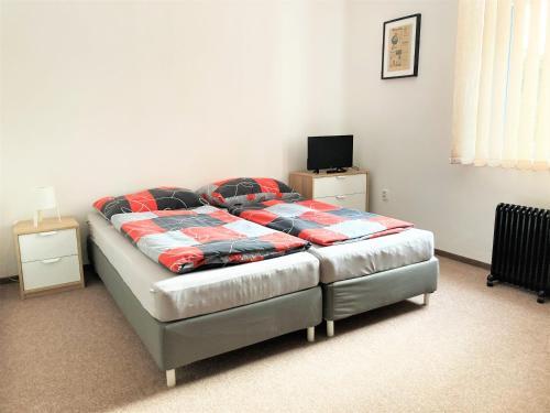 Postel nebo postele na pokoji v ubytování Penzion Zelený Háj