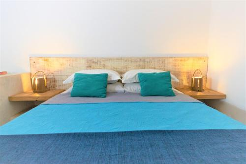 A bed or beds in a room at Vila Emanuelle Pousada Boutique