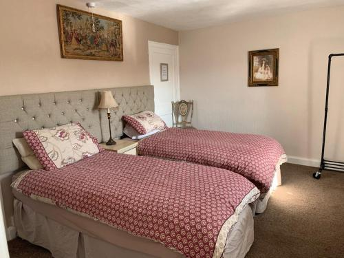 A bed or beds in a room at The Vintage Inn