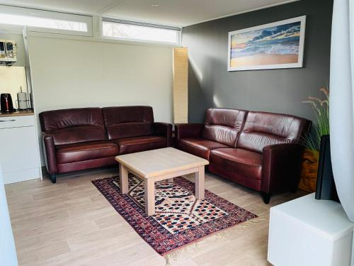 A seating area at Nieuw Huisje nummer 3