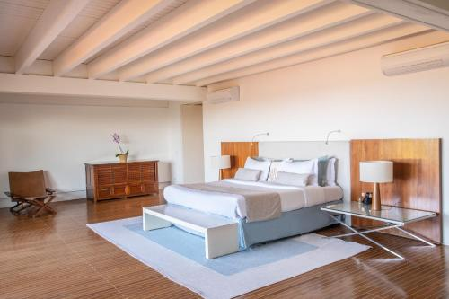 A bed or beds in a room at A Concept Hotel & Spa