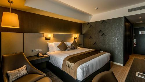 A bed or beds in a room at Crowne Plaza Aberdeen Airport, an IHG Hotel