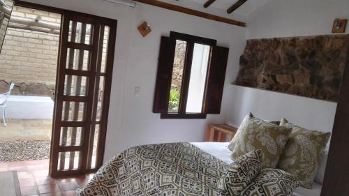 A bed or beds in a room at Casa Tzabar