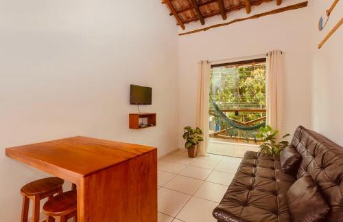Uma área de estar em Apartamentos Recanto da Barra