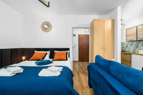 A bed or beds in a room at Sleepway Apartments - Modern Dream