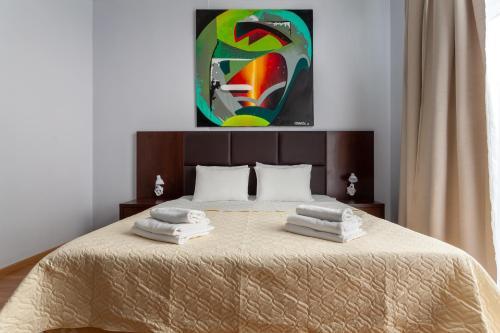 Кровать или кровати в номере Apartments Deluxe