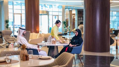 A restaurant or other place to eat at Pullman Sharjah