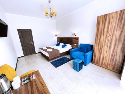 Кровать или кровати в номере Antares бутик-отель