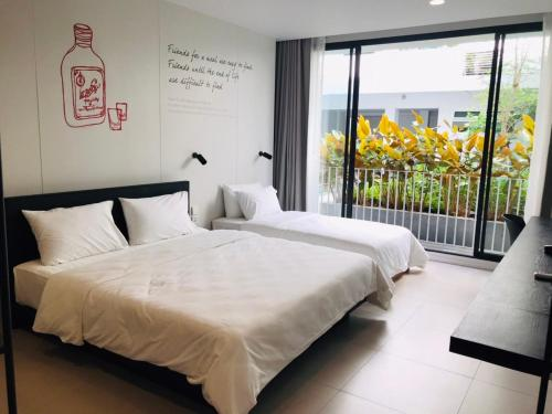 Cama o camas de una habitación en CHERN Bangkok