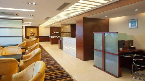 Lobby/Rezeption in der Unterkunft Holiday Inn Shenzhen Donghua, an IHG Hotel