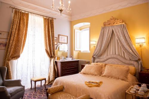 Letto o letti in una camera di Casa Isabella B&B