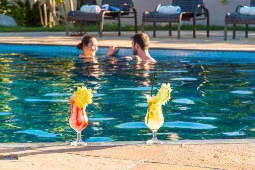 The swimming pool at or near Novo Sol Hotel - Rede Soberano
