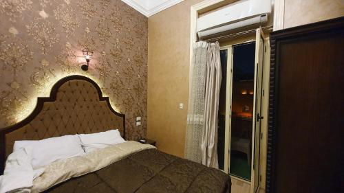 A bed or beds in a room at Heritage Hostel Cairo
