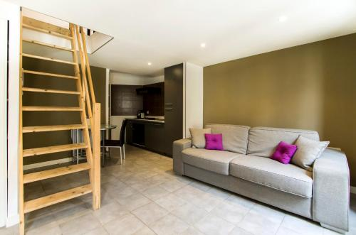 A seating area at Florella Achard Apartment