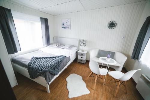 A bed or beds in a room at RabaPark - Domki Pod Krakowem