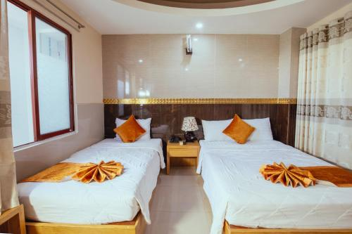 Кровать или кровати в номере Oliver Hotel
