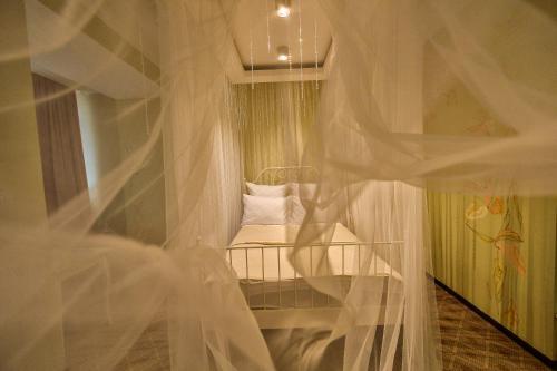 Кровать или кровати в номере Отель ВИЛЛА де ИДАЛЬГО