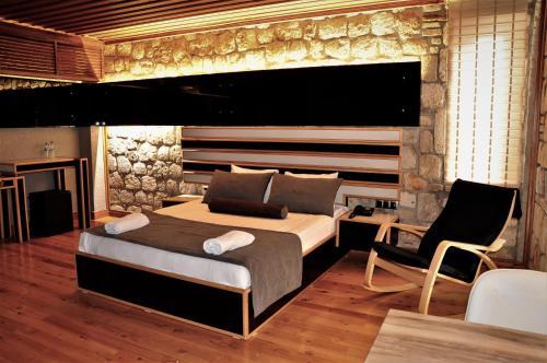 Кровать или кровати в номере Kosa Boutique Hotel