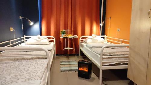 Кровать или кровати в номере Кино Хостел на Московском