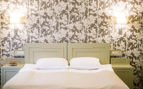 Ein Bett oder Betten in einem Zimmer der Unterkunft Antonius Hotel
