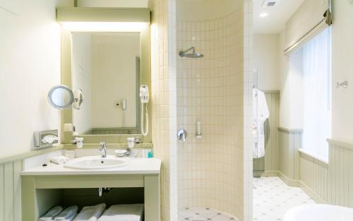 Ein Badezimmer in der Unterkunft Antonius Hotel