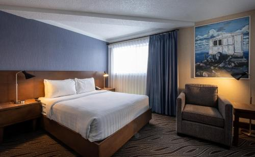 A bed or beds in a room at Prestige Mountain Resort Rossland