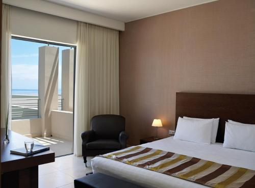 A bed or beds in a room at Atlantica Eleon Grand Resort