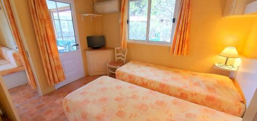 A bed or beds in a room at RESIDENCE TORRE DEL FAR