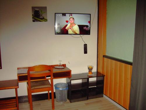 A television and/or entertainment center at Hessisches Haus