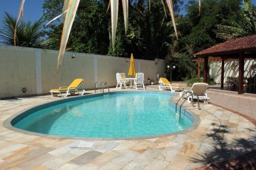 The swimming pool at or close to Village Pendotiba