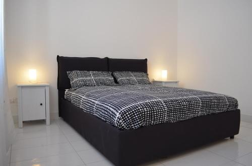 A bed or beds in a room at Case Maiori