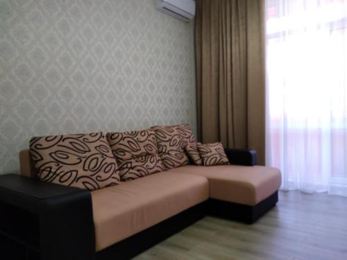 """A seating area at 2 комнатная квартира в ЖК """"Гоголь"""""""