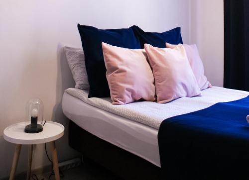 Ένα ή περισσότερα κρεβάτια σε δωμάτιο στο Euro-Room Rooms & Apartments