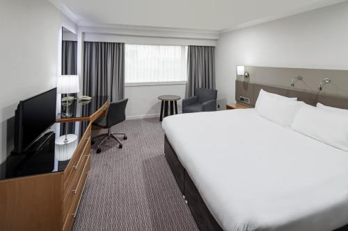 A bed or beds in a room at Crowne Plaza Nottingham, an IHG Hotel