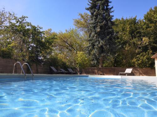 The swimming pool at or near Le Moulin De Connelles