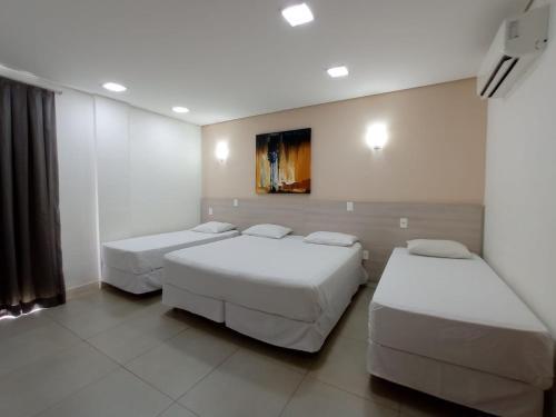 Cama ou camas em um quarto em Hotel Manacá