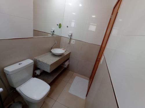 Um banheiro em Hotel Manacá